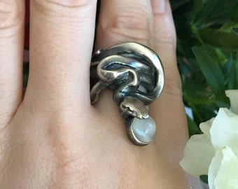 Snake Swallowing the Moon Ring in Oxidized Sterling Silver and with a White Moonstone