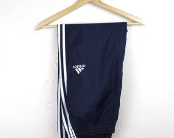 90s Vintage ADIDAS Nylon Joggers Track Pants 3 Stripe Windbreaker Pants Fitted Embroidered Adidas Logo Navy Blue and White Size Medium