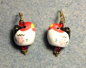 White, black and red ceramic chicken bead earrings adorned with red Czech glass beads.