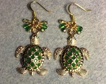 Large green and gold enamel and rhinestone turtle charm earrings adorned with tiny dangling green and gold Czech glass beads.