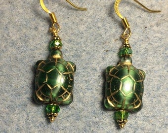 Emerald green Czech glass turtle bead earrings adorned with green Chinese crystal beads.