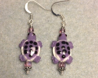 Purple and white spotted lampwork turtle bead earrings adorned with purple Czech glass beads.