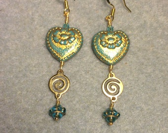 Opaque turquoise with gold inlay Czech glass heart bead dangle earrings adorned with gold swirly links and turquoise Saturn beads.
