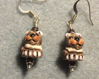 Small brown and tan ceramic exotic cat bead earrings adorned with brown Chinese crystal beads.