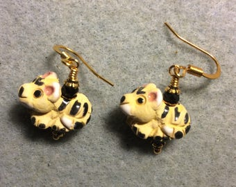 Small yellow, black and white ceramic tiger bead earrings adorned with black Chinese crystal beads.