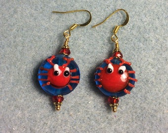 Blue and red lampwork crab bead earrings adorned with red Chinese crystal beads.