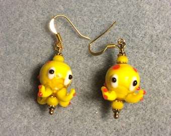 Yellow lampwork octopus bead earrings adorned with yellow Chinese crystal beads.