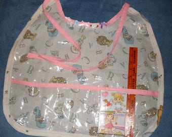 Precious Moments Bib ABDL Clear Plastic Crumb Catcher with (2) 24pc Puzzles