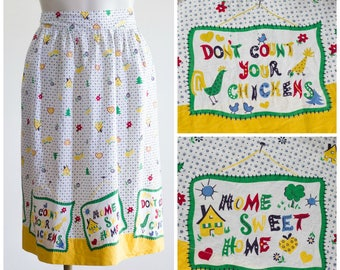 Novelty print half apron from the 50s or 60s