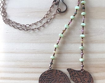 Etched copper elephant pendant on beaded chain