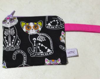Mini zippered bag. Skelli-cats. 11cm x 9cm. Pink strap. Lined. Ideal for lunch money or meter money. Washable. Fun & practical.