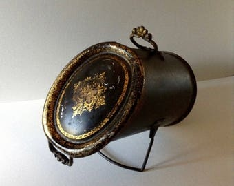 XIX th s. for fireplace coal scuttle. Painted metal light black color with gold screen prints.