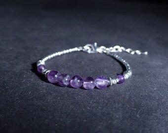Ethnic Amethyst stones and silver bracelet. The bracelet was purple beads.