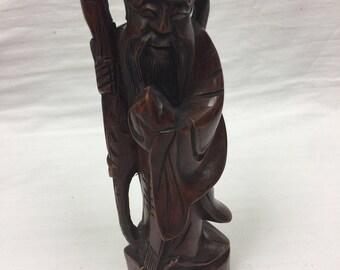 Rosewood wiseman figure