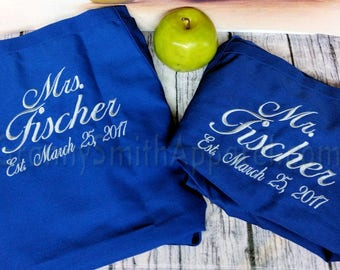 """His / Hers Aprons. Matching set. Custom Embroidered.  Many colors + fonts. 24""""L x 28""""W professional 3 pocket full bib. His can be longer!!!"""