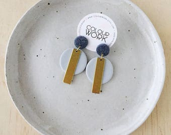 Circle Stick Earrings - Jet Black & Dove Grey with a brass rectangular bar.