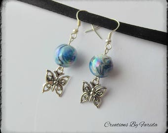 earrings with a butterfly pendant and a Pearl effect blue wave