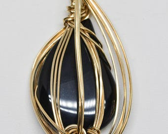 Lovely black and gold tone pendant
