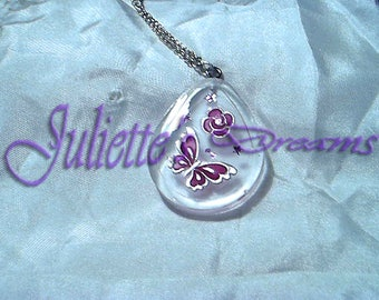 Transparent butterfly and pink flower pendant