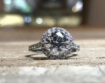 AF Jewelers Mounting Halo Ring for 1 Round Diamond approx 1.50 carat mm 7.20 with 56 Round Diamonds, 18k White Gold.