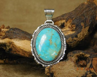 Navajo Made Sterling Silver And Turquoise Pendant
