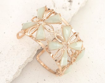 Geometric vintage inspired cuff bracelet in gold with mint stones and line detailing