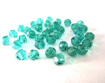 20 rondelle beads emerald green faceted glass 4mm
