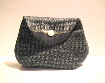 Blue and white pouch inside jeans