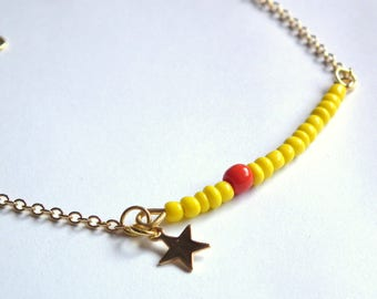 Bracelet gold and yellow seed beads