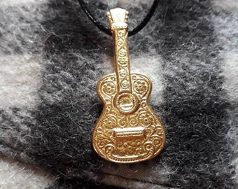 Gold guitar pendant necklace