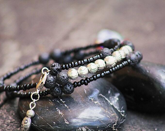 Black organic lava rock wire bracelet