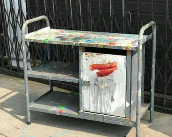 INDUSTRIAL ARTISTS CABINET: A stunning metal artist cabinet with worktop, 2 shelves and cupboard. Complete with original paint!