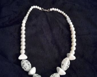 Lovely white beaded necklace.