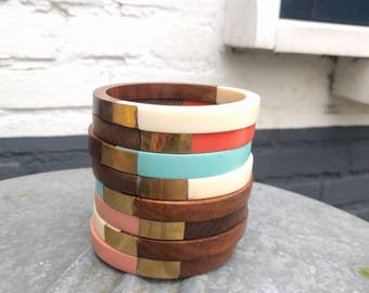 VINTAGE wood and plastic bangle in different colors with brass finish.