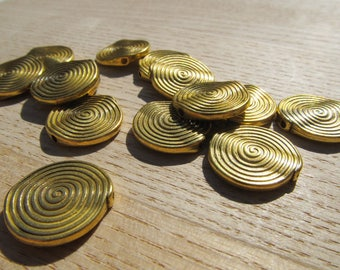 Set of 10 flat round beads 18 mm metal color antique gold.