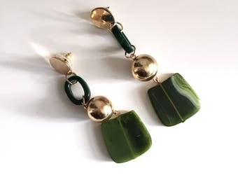 Green dangle sphere earrings