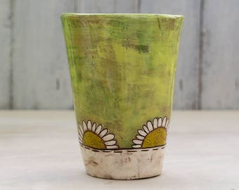 green glass ceramic with daisies