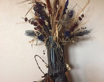 Dried Floral Arrangements on Driftwood