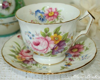 Aynsley, England: Crocus tea cup and saucer with flowers