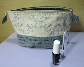 Zipped pouch in nostalgic linen printed with birds and script fabric