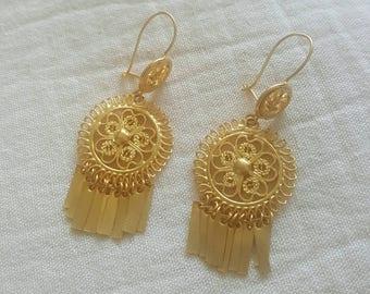 Golden filigree earrings. Oaxaca, Mexico