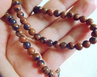 6 BLUE GOLD SAND BROWN GOLDSTONE BEADS. 6 MM.
