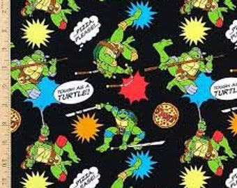 """TMNT pizza toss on black by Spirings Creative fabric, 43"""" wide, 100% cotton, by the half yard"""