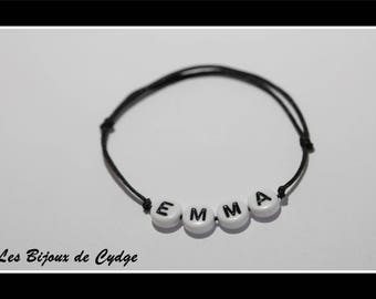 Black bracelet with name for child and his bow slide