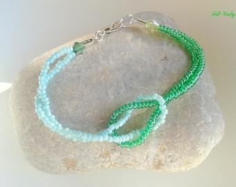 Cross bracelet green seed beads