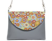 handbag with chain shoulder strap in imitation leather and fabric flap