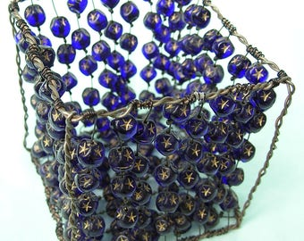 Candle 'square' with beads in the shape of dice. color dark blue transparent. Metal