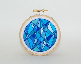 Blue abstract mosaic-style embroidered wall hanging