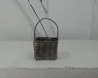 Silver metallic woven vintage basket