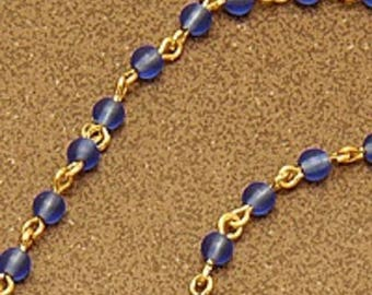 Azure spectacle chain - Sky blue glass beads on gold-plated links